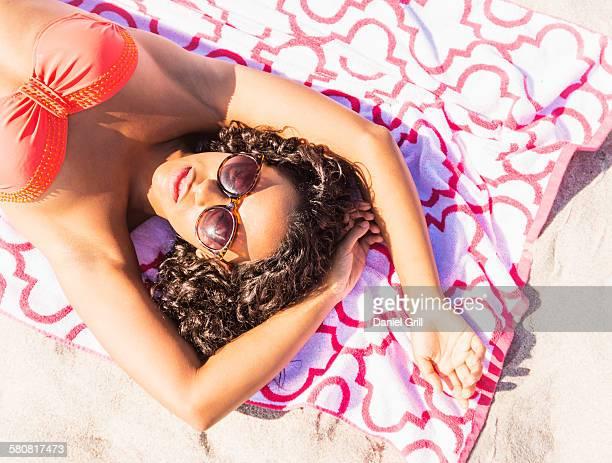 USA, Florida, Jupiter, Young woman sunbathing on beach