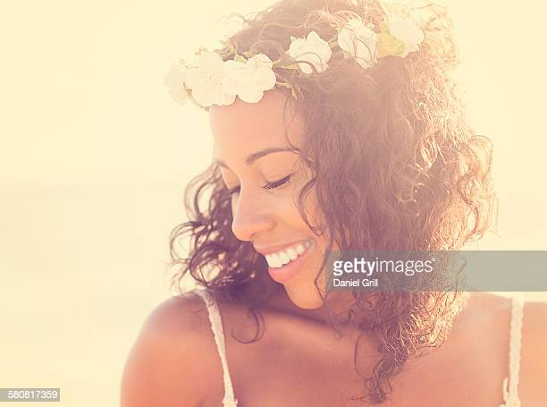USA, Florida, Jupiter, Young woman wearing wreath