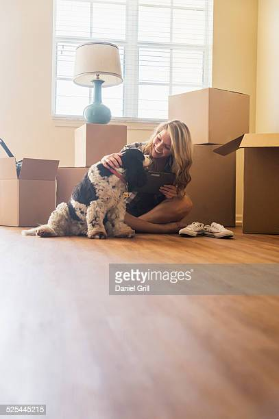 USA, Florida, Jupiter, Young woman with dog in their new house