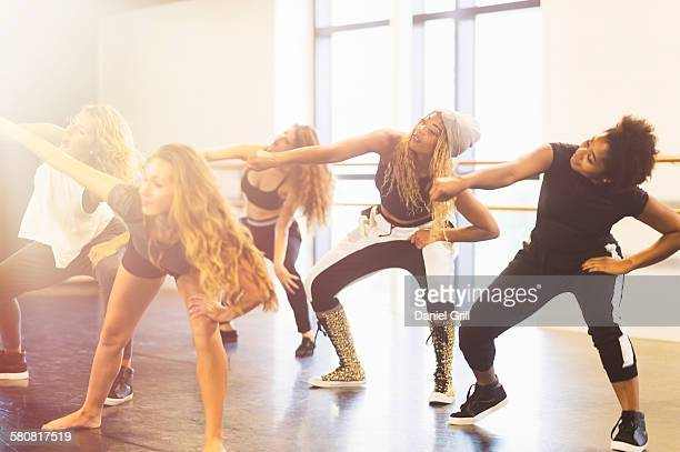 USA, Florida, Jupiter, Young women dancing in dance studio