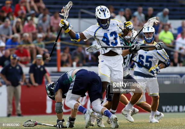 Florida Launch Mark Mcneill scoops up a loose ball over multiple Chesapeake Bayhawks defenders during a match between the Chesapeake Bayhawks and the...