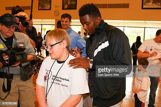 Florida Linebacker Dante Fowler Jr signs the shirt of Evan Schaumberg at the Shriners Childrens Hospital in Chicago The event brought 19 2015 NFL...