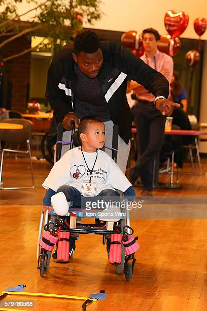 Florida Linebacker Dante Fowler works with Joshua Mallory at the Shriners Childrens Hospital in Chicago The event brought 19 2015 NFL Draft Picks to...