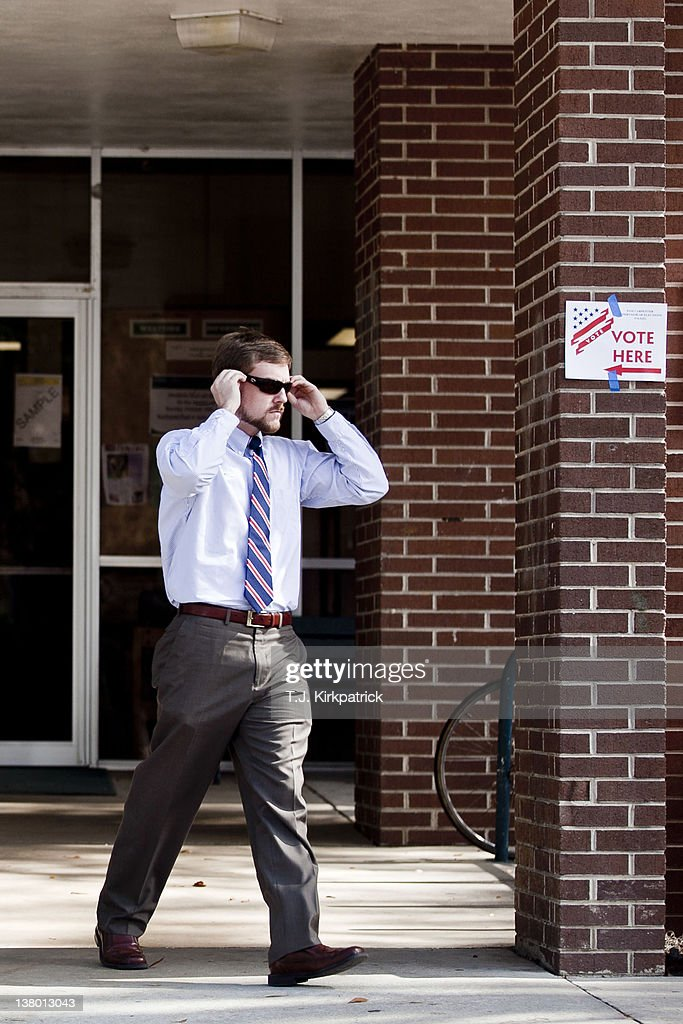 A Florida man leaves the polls after voting in the state's Republican Party primary at the Westside Recreation Center on January 31, 2012 in Gainesville, Florida. After a decisive South Carolina win, former House speaker Newt Gingrich has risen and fallen in the polls and trails former Massachusetts Gov. Mitt Romney by double digits going in to Florida's primary.