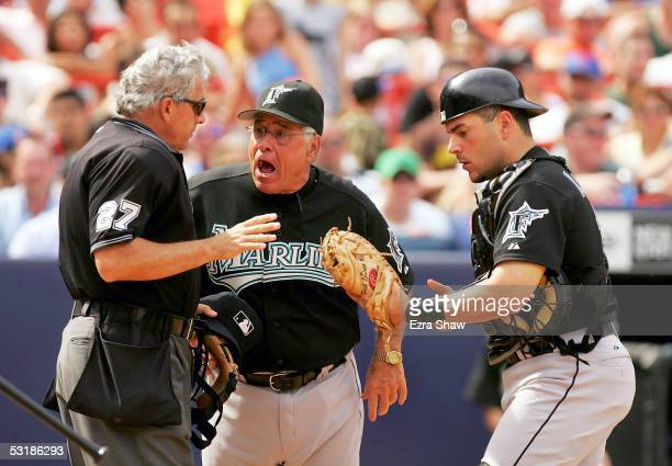 Florida Marlins manager Jack McKeon argues with home plate umpire Larry Vanover that the catcher Paul Lo Duca caught the ball and that the hitter...