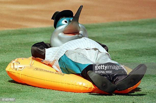 Florida Marlins mascot Billy the Marlin relaxes on an inflatable boat on the field before the game between the Marlins and the New York Mets 14 June...