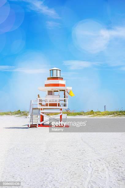 USA, Florida, Miami Beach. Lifeguard tower on beach with yellow flag