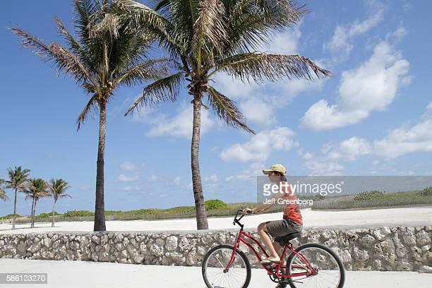 Florida Miami Beach Lummus Park Asian woman riding a bike