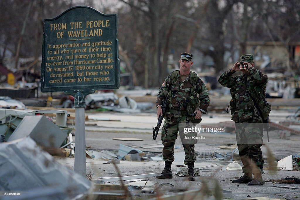 Florida National Guard 124th Infantry Unit Sergeant Tony Knight and Sergeant Lee Phillips look at a sign dedicated to Hurricane Camille as they...
