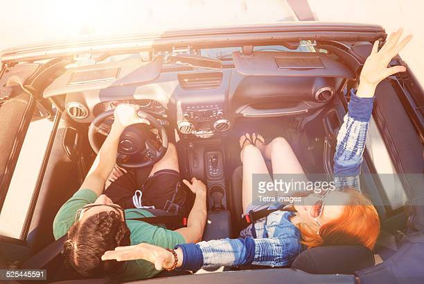 USA, Florida, Palm Beach, Elevated view of couple in car