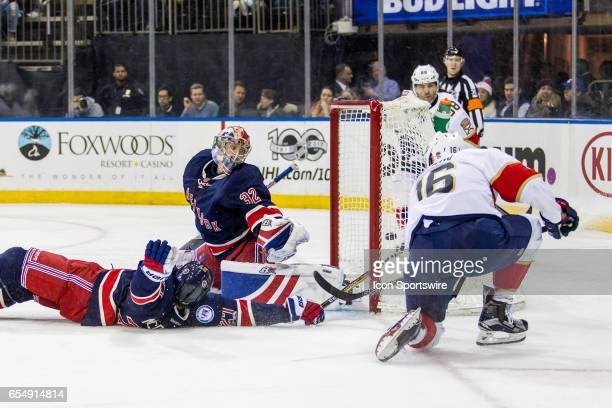 Florida Panthers Center Aleksander Barkov scores as New York Rangers Defenseman Ryan McDonagh slides across the ice during the third period of an...