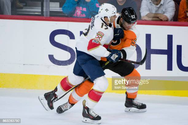 Florida Panthers Center Derek MacKenzie checks Philadelphia Flyers Defenceman Shayne Gostisbehere in the first period during the game between the...