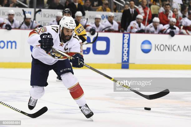 Florida Panthers Center Derek MacKenzie moves the puck during the first period in the NHL game between the Pittsburgh Penguins and the Florida...