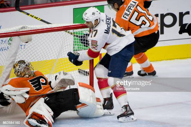 Florida Panthers Center Derek MacKenzie smashes into Philadelphia Flyers Goalie Michal Neuvirth in the second period during the game between the...