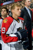 Florida Panthers center Stephen Weiss stands for the national anthems before a game against the Edmonton Oilers at Rexall Place on October 10 2010 in...
