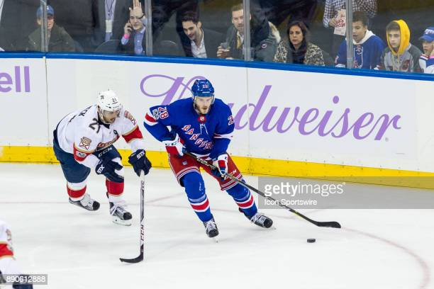 Florida Panthers Center Vincent Trocheck chases after New York Rangers Winger Paul Carey during the second period of a regular season NHL game...