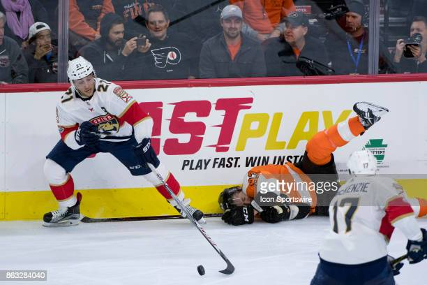 Florida Panthers Center Vincent Trocheck reaches out for the puck past a fallen Philadelphia Flyers Right Wing Jakub Voracek in the third period...
