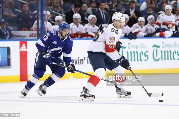 Florida Panthers defenseman Joshua Brown takes control of the puck infant of Tampa Bay Lightning center Cedric Paquette in the 1st period of the NHL...