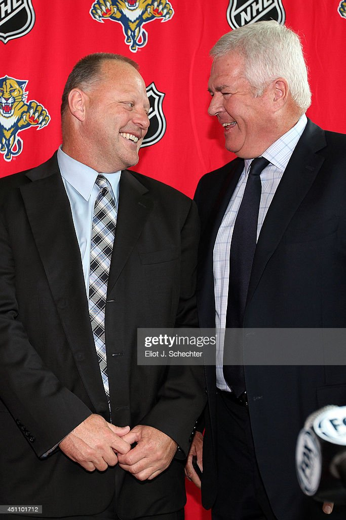 Florida Panthers Executive Vice President and General Manager Dale Tallon (R) announces that <a gi-track='captionPersonalityLinkClicked' href=/galleries/search?phrase=Gerard+Gallant&family=editorial&specificpeople=704668 ng-click='$event.stopPropagation()'>Gerard Gallant</a> has been named the club's new head coach at the BB&T Center on June 23, 2014 in Sunrise, Florida.