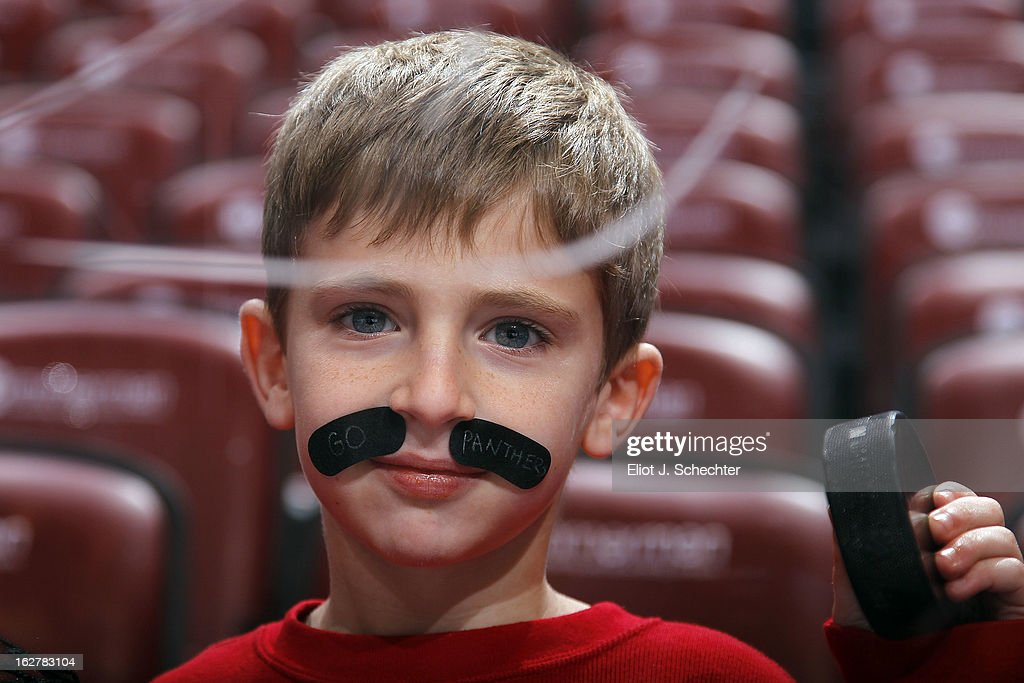 A Florida Panthers fan sports a George Parros-style mustache prior to the start of the game against the Boston Bruins at the BB&T Center on February 24, 2013 in Sunrise, Florida.