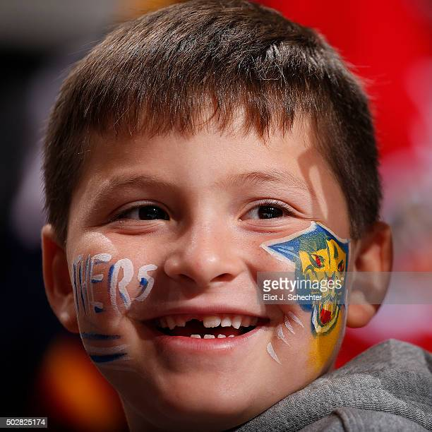 Florida Panthers fans have their faces painted in support of their team against the Ottawa Senators at the BBT Center on December 22 2015 in Sunrise...