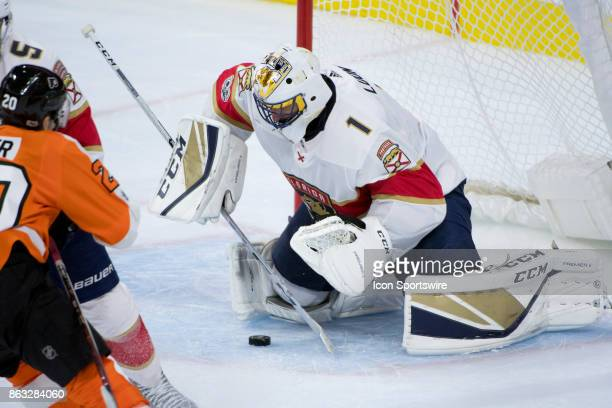 Florida Panthers Goalie Roberto Luongo covers up the puck after a save in the third period during the game between the Florida Panthers and...