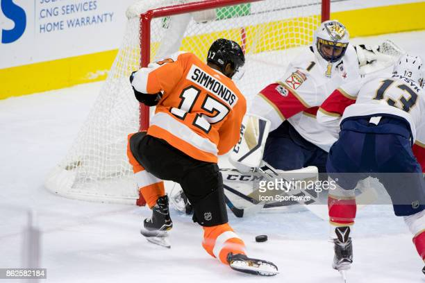 Florida Panthers Goalie Roberto Luongo makes a diving save against Philadelphia Flyers Right Wing Wayne Simmonds in the first period during the game...
