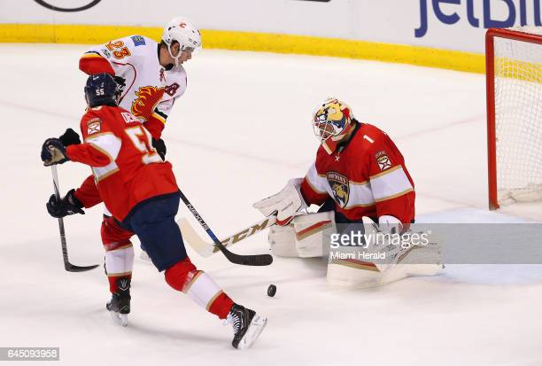 Florida Panthers goalie Roberto Luongo makes a save during a game against Calgary Flames center Sean Monahan during the first period at BBT Center in...