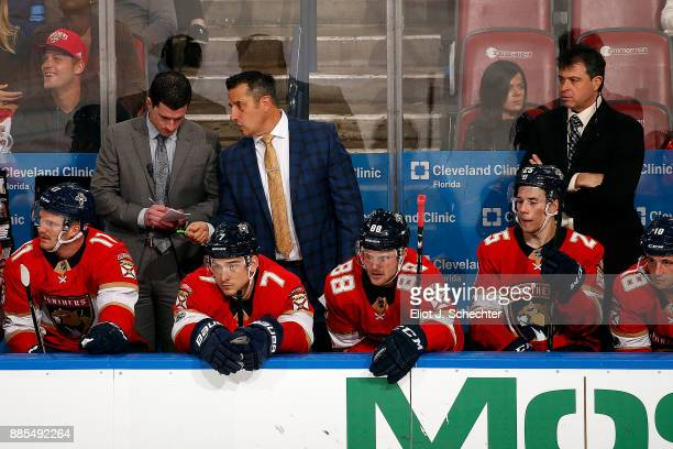 Florida Panthers Head Coach Bob Boughner chats with Assistant Coach Paul McFarland while Associate Coach Jack Capuano looks on during a break in the...