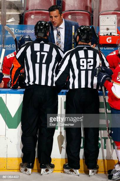 Florida Panthers Head Coach Bob Boughner chats with NHL Referee Frederick L'Ecuyer and NHL Linesmen Mark Shewchyk during a break in the action...