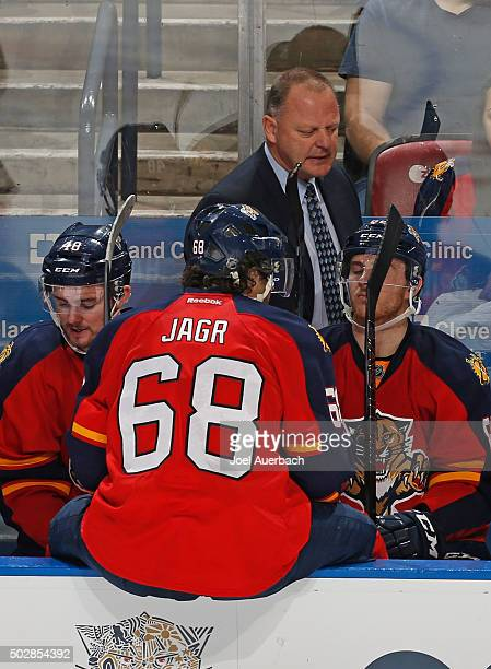 Florida Panthers head coach Gerald Gallant talks to Jaromir Jagr of the Florida Panthers during a break in action against the Montreal Canadiens at...