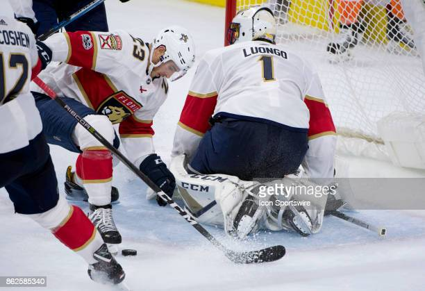 Florida Panthers Left Wing Connor Brickley recovers a loose puck saved by Florida Panthers Goalie Roberto Luongo in the third period during the game...