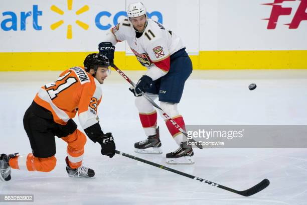 Florida Panthers Left Wing Jonathan Huberdeau and Philadelphia Flyers Center Scott Laughton chase down the puck in the second period during the game...