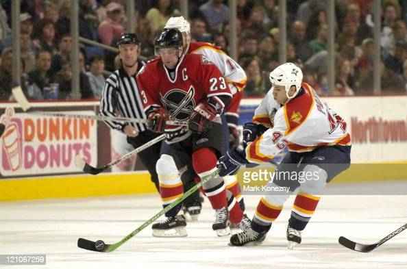 Florida Panthers left wing Serge Payer controls the puck in front of Buffalo Sabres center Chris Drury in a game at HSBC Arena in Buffalo New York on...