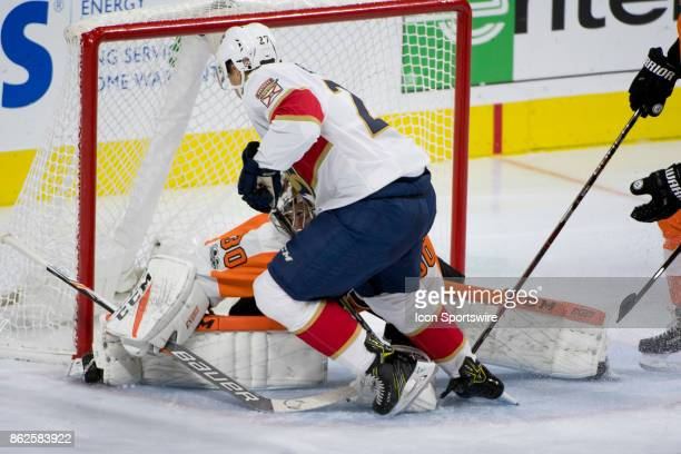 Florida Panthers Winger Nick Bjugstad crashes into Philadelphia Flyers Goalie Michal Neuvirth in the second period during the game between the...