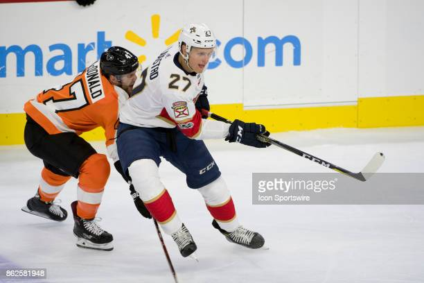 Florida Panthers Winger Nick Bjugstad keeps the puck away from Philadelphia Flyers Defenceman Andrew MacDonald in the first period during the game...