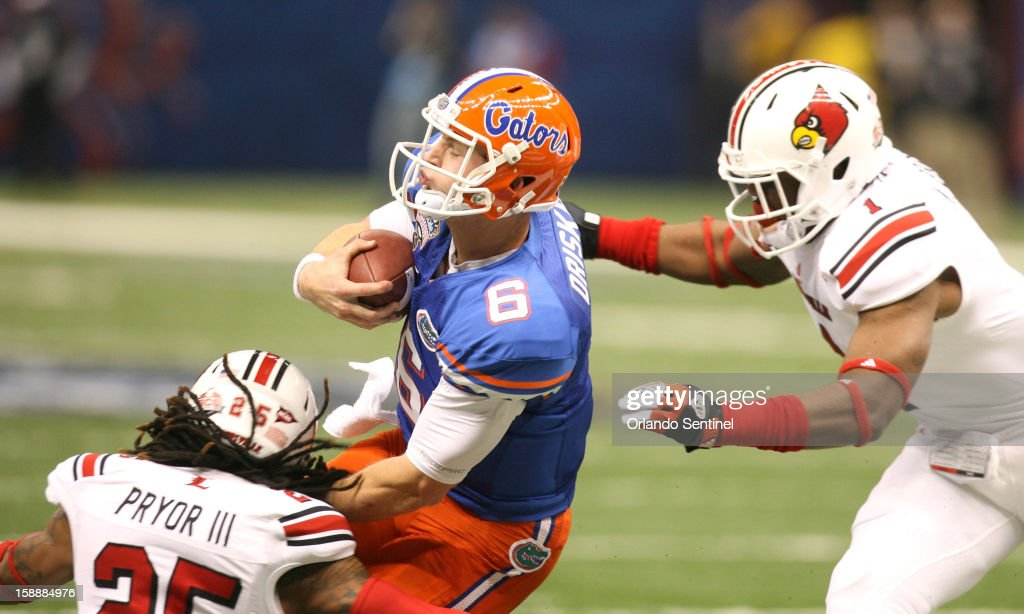 Florida quarterback Jeff Driskel (6) is tackled by Louisville's Calvin Pryor (25) and Keith Brown (1) in the Allstate Sugar Bowl at the Mercedes-Benz Superdome on Wednesday, January 2, 2013, in New Orleans, Louisiana.