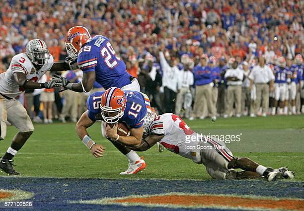 Florida quarterback Tim Tebow eludes the tackle of Ohio State's Donald Washington and breaks the plane of the endzone on a 4th quarter touchdown run...