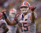 Florida quarterback Tim Tebow motions to the crowd after scoring a touchdown during the second half against Florida State Florida defeated Florida...