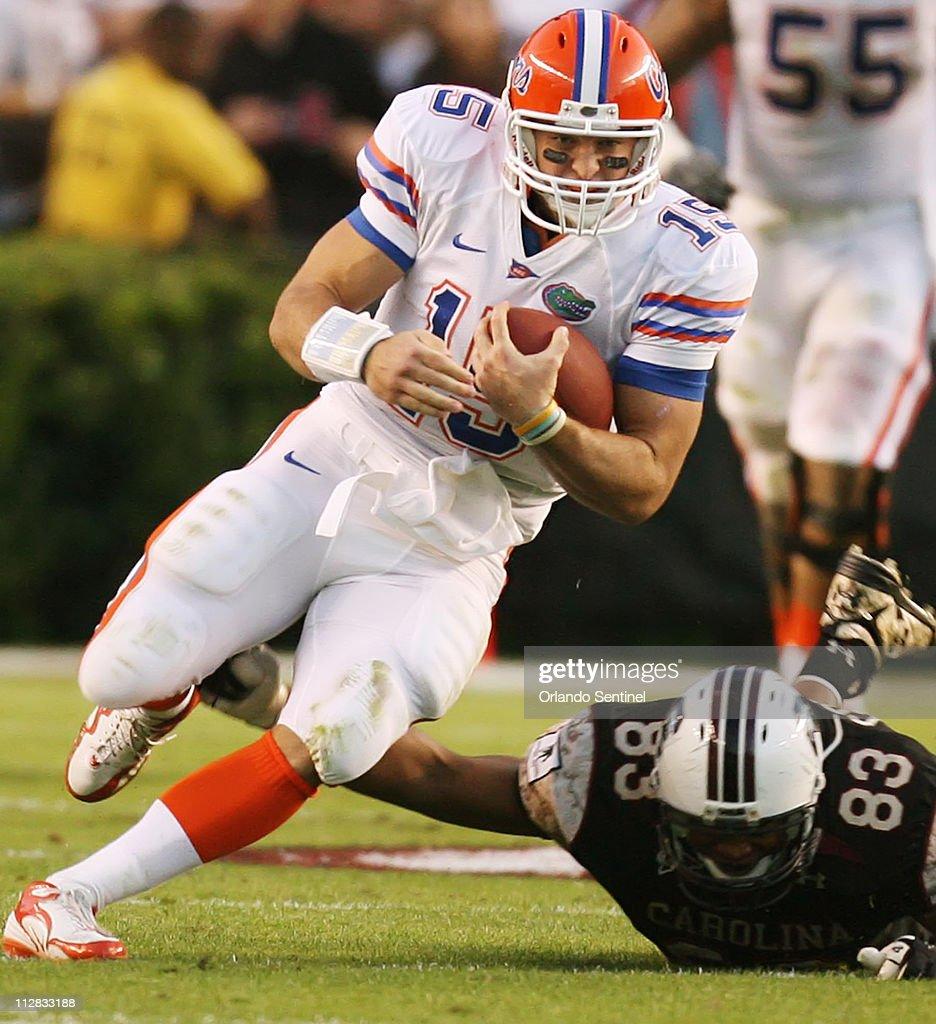 Florida quarterback Tim Tebow runs past South Carolina defensive end Cliff Matthews during a first-down run at Williams-Brice Stadium in Columbia, South Carolina, on Saturday, November 14, 2009.