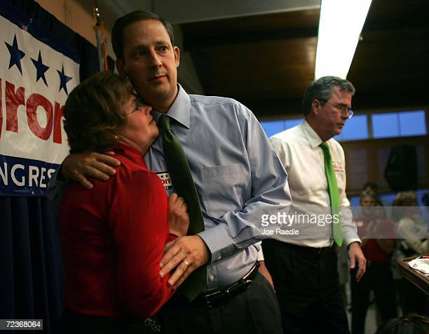 Florida Republican US Congressional candidate Joe Negron hugs his wife Rebecca Negron during a campaign event with Florida Governor Jeb Bush November...
