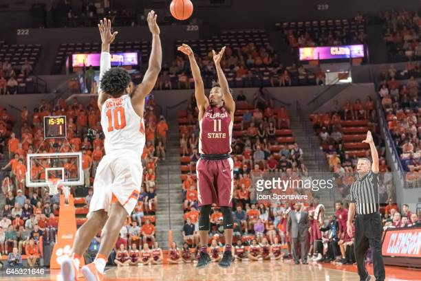 Florida St guard Braian Angola Rodas shoots over Clemson guard Gabe DeVoe during 1st half action between the Clemson Tigers and the Florida State...