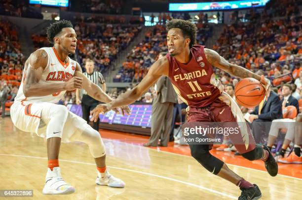 Florida St guard Braian Angola Rodas tries to get around Clemson forward Jaron Blossomgame during 1st half action between the Clemson Tigers and the...