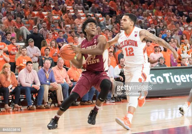 Florida St guard Terance Mann is guarded closely by Clemson guard Avry Holmes during 1st half action between the Clemson Tigers and the Florida State...