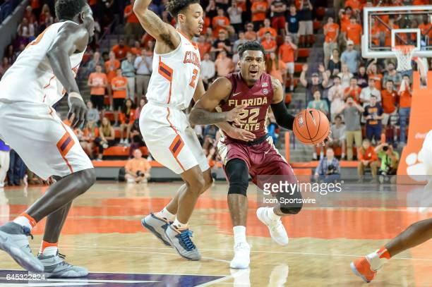 Florida St guard Xavier Rathan Mayes tries to get by Clemson guard Marcquise Reed during 1st half action between the Clemson Tigers and the Florida...