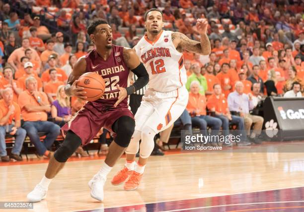 Florida St guard Xavier Rathan Mayes tries to get by Clemson guard Avry Holmes during 1st half action between the Clemson Tigers and the Florida...