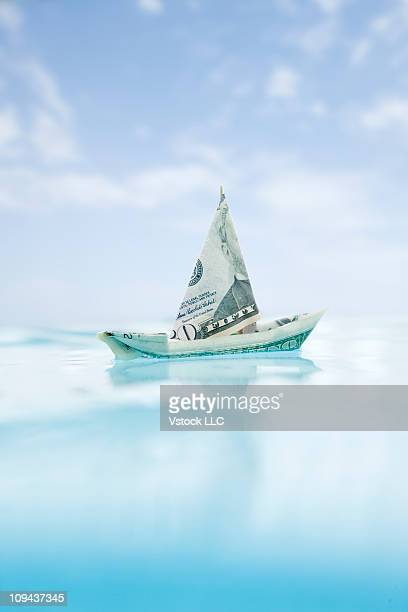USA, Florida, St. Petersburg, Money boat floating on water in swimming pool