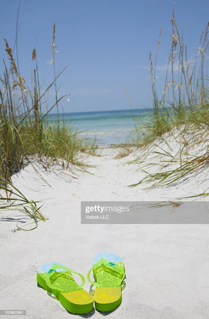 USA, Florida, St. Petersburg, Pair of flip flops on sandy beach : Stock Photo