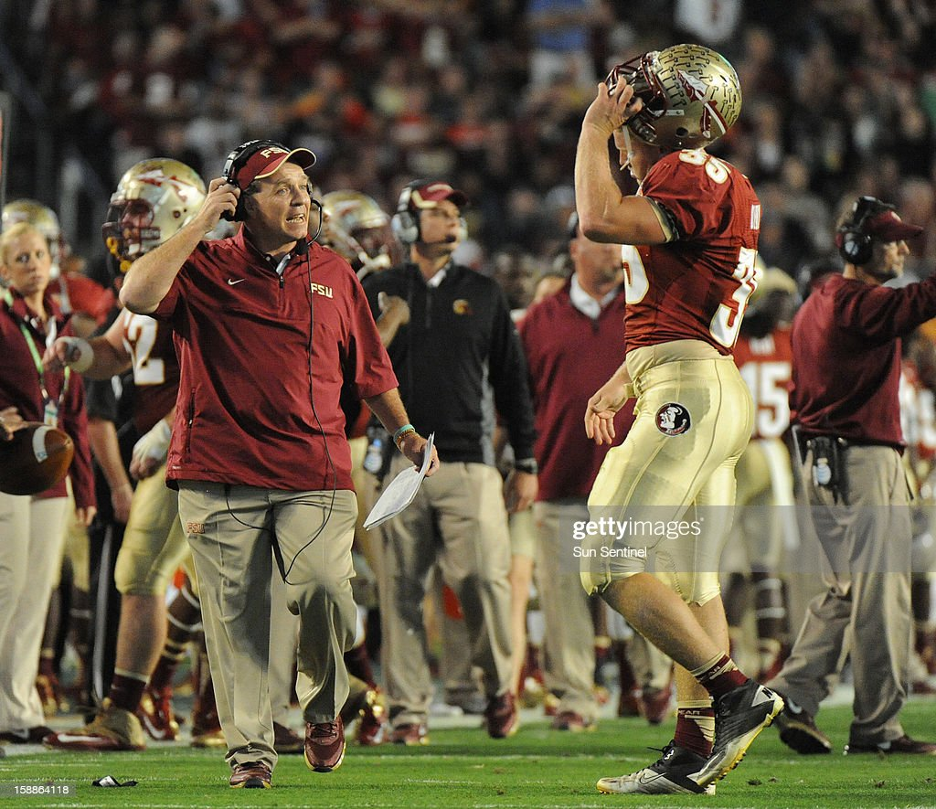 Florida State Coach Jimbo Fisher has a word with Nick O'Leary after his fumble against Northern Illinois during the first half of the Discover Orange Bowl on Tuesday, January 1, 2013, in Miami Gardens, Florida.