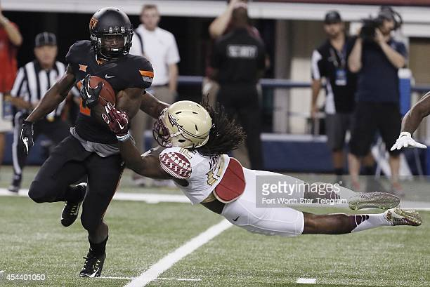 Florida State defensive back Malique Jackson right attempts to tackle Oklahoma State wide receiver Tyreek Hill on a kickoff return during the first...